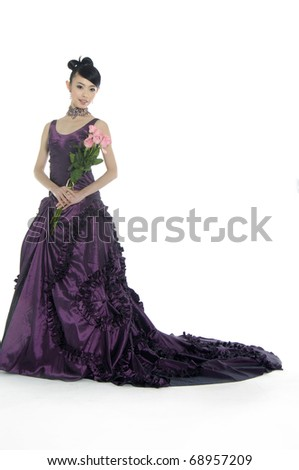 happy bride with red rose flower - stock photo