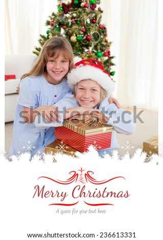 Happy brother and sister holding Christmas presents against border - stock photo