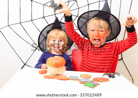 happy brother and sister on Halloween party - stock photo