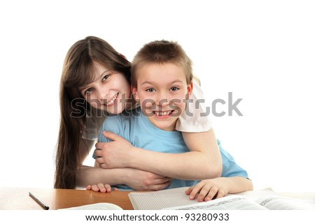 happy brother and sister on the table with exercise books