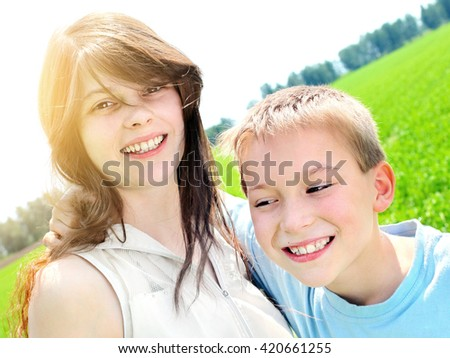 Happy Brother and Sister Portrait at the Summer Field - stock photo
