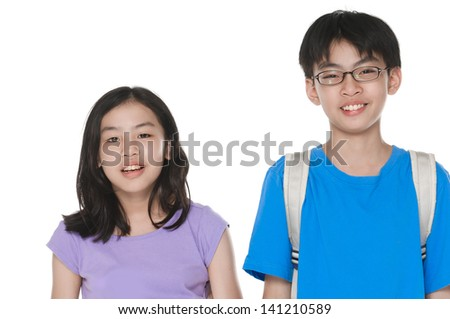 happy brother and sister studio portrait on white background - stock photo