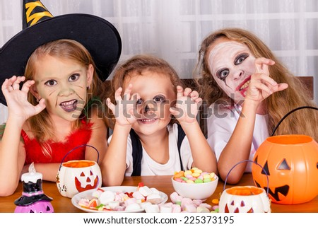 Happy brother and two sisters on  Halloween party. Concept of death on  Halloween. - stock photo