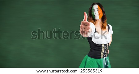 Happy brunette against green chalkboard