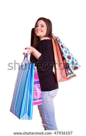 happy brunette girl standing  with shopping paper bags