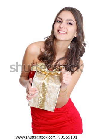 Happy brunette with a present - stock photo