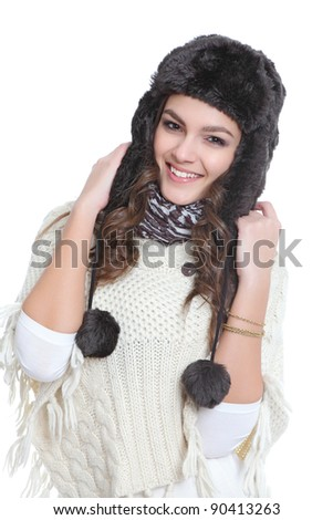 Happy brunette with fur hat - stock photo