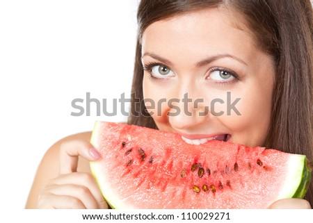 happy brunette woman biting slice of watermelon - stock photo