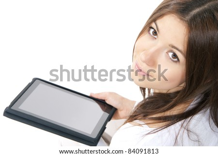 Happy brunette woman holding in hand new electronic tablet touch pad computer one finger touch digital screen and smiling, looking at the camera on a white background - stock photo