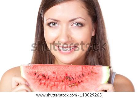 happy brunette woman holding slice of watermelon - stock photo