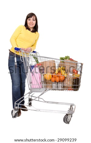 happy brunette woman with shopping cart. over white background - stock photo