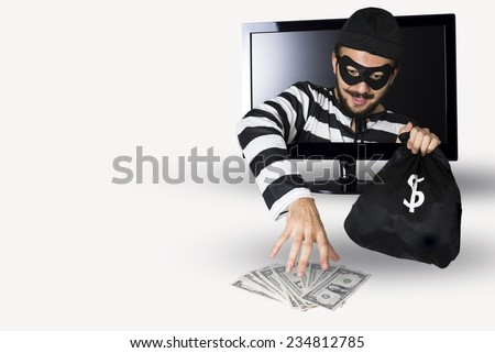 Happy Burglar stealing money in a computer monitor on a white background. - stock photo