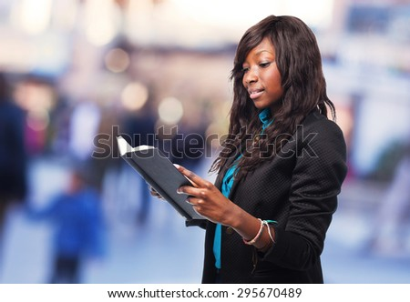 happy business black woman reading a book - stock photo