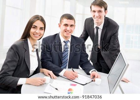 Happy business colleagues looking at camera - stock photo