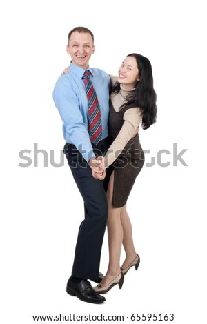 Happy business couple dancing and laughing against white background - stock photo