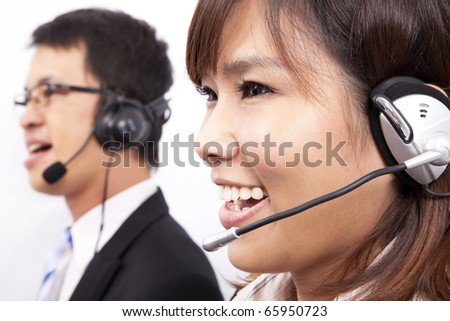 Happy business customer support girl with a headset - stock photo