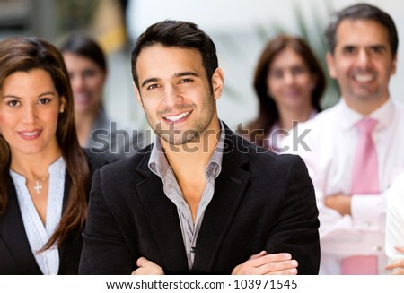 Happy business group at the office smiling - stock photo