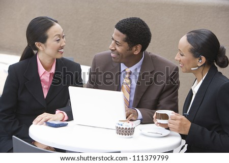 Happy business group having discussion during coffee break