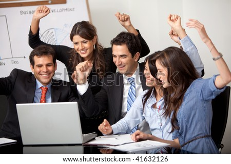 Happy business group in a meeting at the office - stock photo