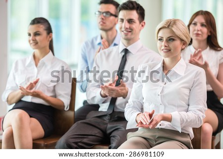 Happy business group of people clapping hands during a meeting conference. - stock photo