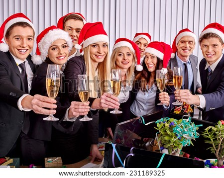 Happy business group people in santa hat drinking champagne  Xmas - stock photo