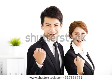 happy business man and woman standing  in office - stock photo
