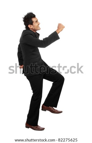 Happy business man climbing over white background - stock photo