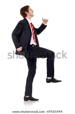 Happy business man climbing over white backgroung