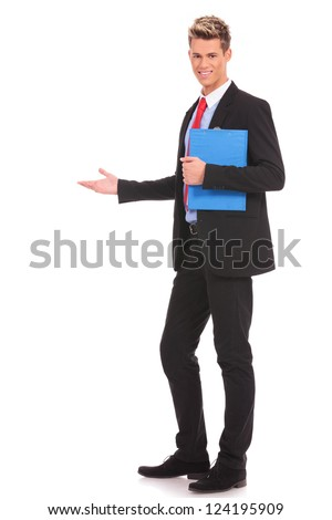 Happy business man giving presentation holding a clipboard in his hand and showing something, on white background