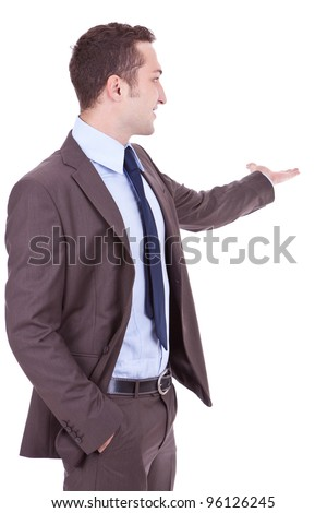 Happy business man giving presentation on white background . young businessman with his arm outstretched , showing you something at his back side - stock photo