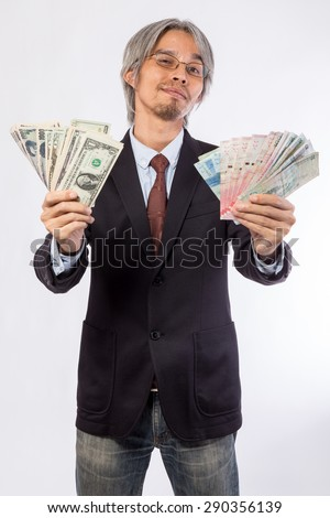 Happy business man hold China , hongkong , united state of america, korea and japan money over a white background, asian model - stock photo