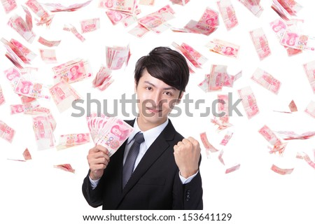 Happy business man hold China money ( Renminbi ) under a money rain - isolated over a white background, asian model - stock photo