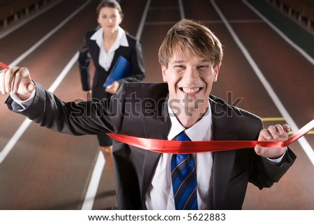 Happy business man is winning a business race - stock photo