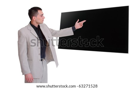 Happy business man presenting and showing on flat screen TV with copy space for your text isolated on white background - stock photo