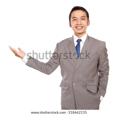 Happy business man presenting, isolated on white background