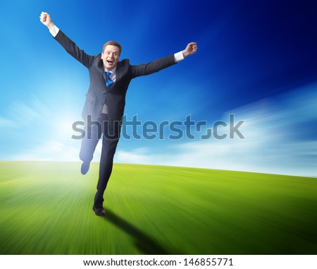 happy business man running on blured spring field - stock photo