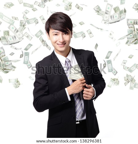 happy business man with earned dollar bills us money in suit pocket under a money rain - isolated over a white background, asian model - stock photo