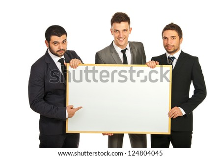 Happy business men team holding blank banner isolated on white background - stock photo