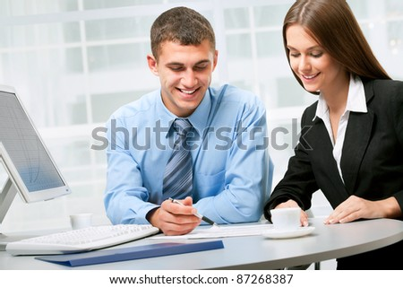 Happy business partners in an  modern office