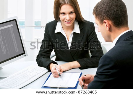 Happy business partners in an  modern office - stock photo