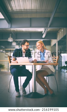 Happy business partners networking in office - stock photo
