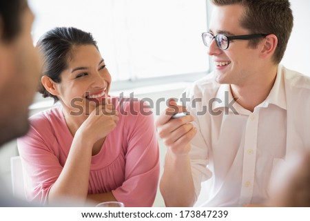 Happy business people discussing in meeting at office - stock photo