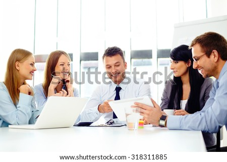 Happy business people during corporate meeting - stock photo