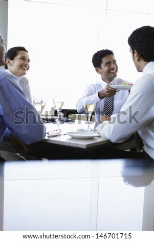 Happy business people having lunch at restaurant - stock photo