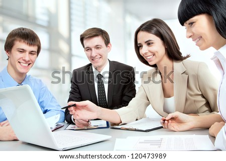 Happy business people in a meeting at office - stock photo