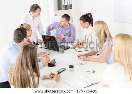 Happy Business people in the office discussing project on laptop at meeting. - stock photo