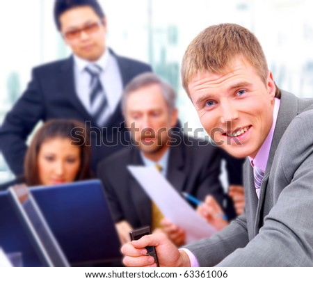 Happy business people seated in a row - stock photo