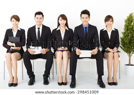 happy business people sitting on the chairs - stock photo