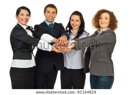 Happy business people standing with their hands on top each other and smiling isolated on white background