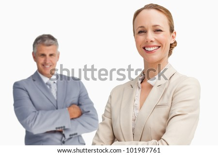 Happy business people with folded arms against white background - stock photo